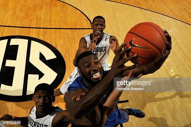 Patric Young of the Florida Gators jumps for a rebound against the Vanderbilt Commodores at Memorial Gym on February 25 2014 in Nashville Tennessee