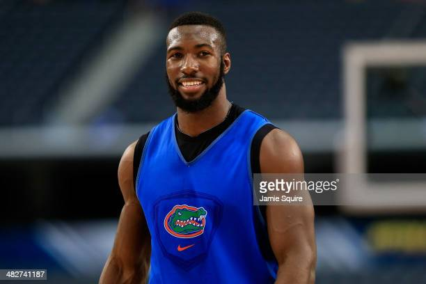 Patric Young of the Florida Gators looks on as the Gators practice ahead of the 2014 NCAA Men's Final Four at ATT Stadium on April 4 2014 in...