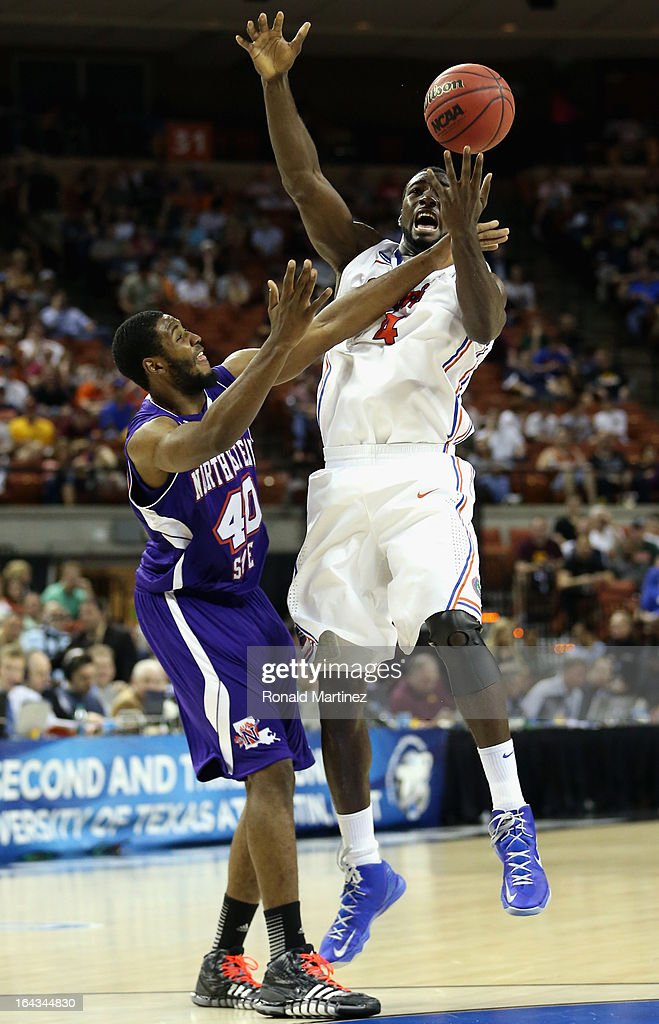 Patric Young #4 of the Florida Gators plays against Marvin Frazier #40 of the Northwestern State Demons during the second round of the 2013 NCAA Men's Basketball Tournament at The Frank Erwin Center on March 22, 2013 in Austin, Texas.