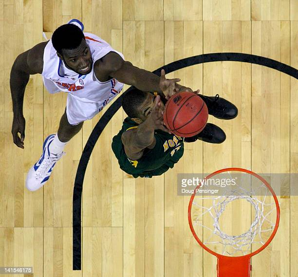 Patric Young of the Florida Gators reaches for a rebound in the first half against Kyle O'Quinn of the Norfolk State Spartans during the third round...