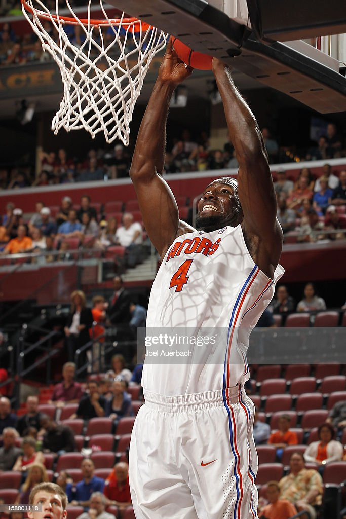 Patric Young #4 of the Florida Gators scores two points against the Air Force Falcons at the MetroPCS Orange Bowl Basketball Classic on December 29, 2012 at the BB&T Center in Sunrise, Florida.