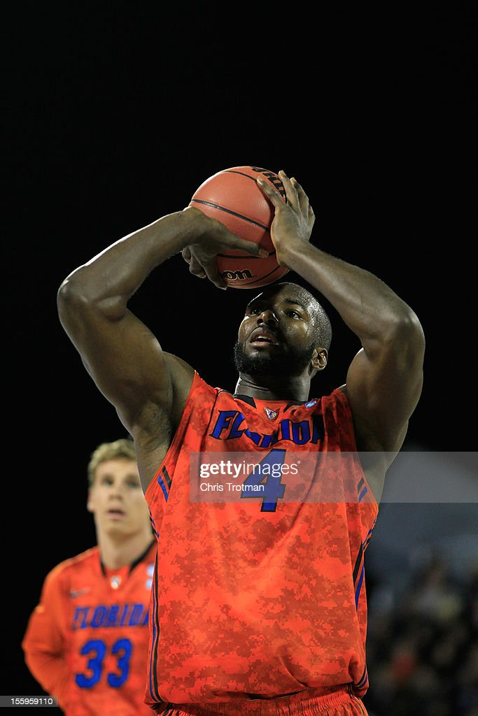 Patric Young #4 of the Florida Gators shoots a free throws as teammate Erik Murphy #33 of the Florida Gators looks on against the Georgetown Hoyas during the Navy-Marine Corps Classic aboard the USS Bataan at Mayport Naval Air Station on November 9, 2012 in Jacksonville, Florida.
