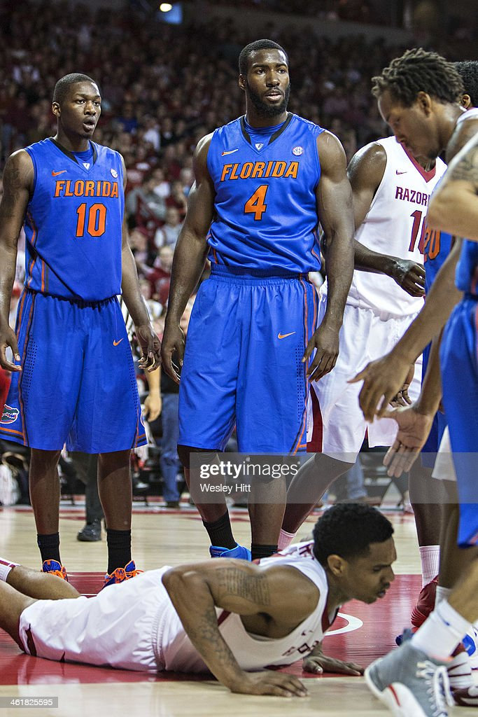 <a gi-track='captionPersonalityLinkClicked' href=/galleries/search?phrase=Patric+Young&family=editorial&specificpeople=7405616 ng-click='$event.stopPropagation()'>Patric Young</a> #4 of the Florida Gators stands over Coty Clarke #4 of the Arkansas Razorbacks after committing a foul at Bud Walton Arena on January 11, 2014 in Fayetteville, Arkansas. The Gators defeated the Razorbacks 84-82.