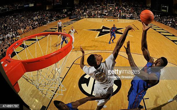 Patric Young of the Florida Gators takes a shot over Damian Jones of the Vanderbilt Commodores at Memorial Gym on February 25 2014 in Nashville...