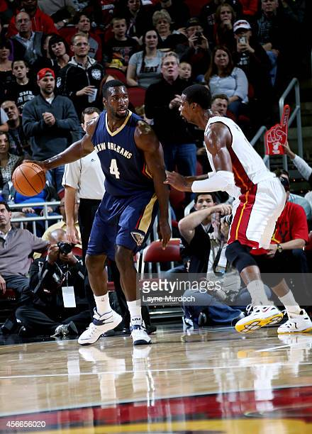 Patric Young of the New Orleans Pelicans handles the ball against Chris Bosh of the Miami Heat during an NBA game on October 4 2014 at the KFC Yum...