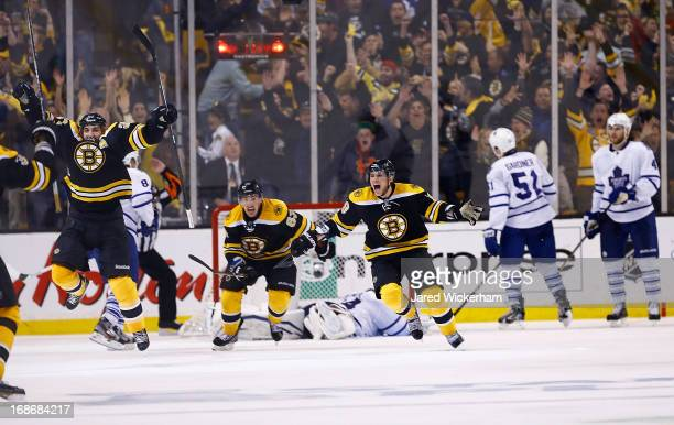 Patrice Bergeron and Tyler Seguin of the Boston Bruins celebrate following Bergeron's gamewinning overtime goal against the Toronto Maple Leafs in...