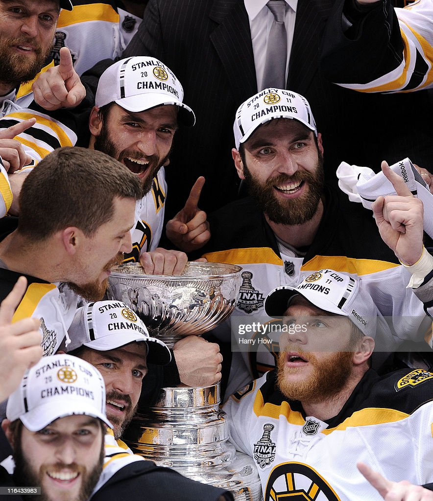 Patrice Bergeron Andrew Ference Mark Recchi and Zdeno Chara of the Boston Bruins pose with the Stanley Cup after defeating the Vancouver Canucks in...