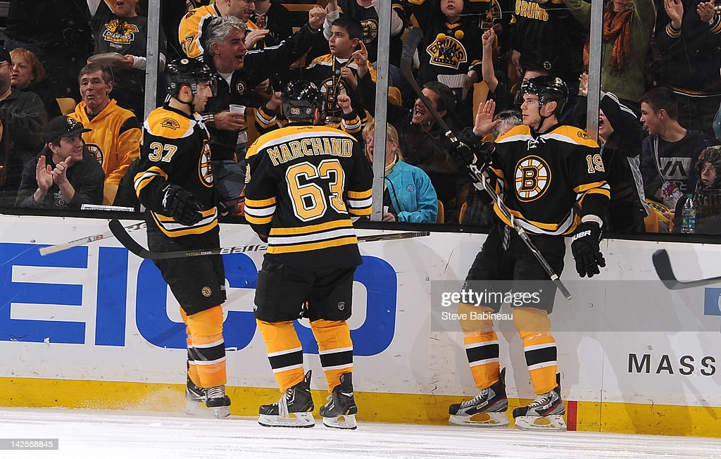 <a gi-track='captionPersonalityLinkClicked' href=/galleries/search?phrase=Patrice+Bergeron&family=editorial&specificpeople=204162 ng-click='$event.stopPropagation()'>Patrice Bergeron</a> #37, <a gi-track='captionPersonalityLinkClicked' href=/galleries/search?phrase=Brad+Marchand&family=editorial&specificpeople=2282544 ng-click='$event.stopPropagation()'>Brad Marchand</a> #63 and <a gi-track='captionPersonalityLinkClicked' href=/galleries/search?phrase=Tyler+Seguin&family=editorial&specificpeople=6698848 ng-click='$event.stopPropagation()'>Tyler Seguin</a> #19 of the Boston Bruins celebrate a goal against the Buffalo Sabres at the TD Garden on April 7, 2012 in Boston, Massachusetts.