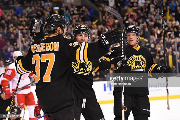 Patrice Bergeron Brett Connolly and Joonas Kemppainen of the Boston Bruins celebrate a goal against the Detroit Red Wings at the TD Garden on...