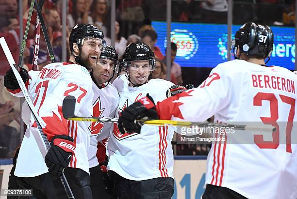 Patrice Bergeron celebrates with Alex Pietrangelo John Tavares and Sidney Crosby of Team Canada after scoring a second period goal on Team USA during...