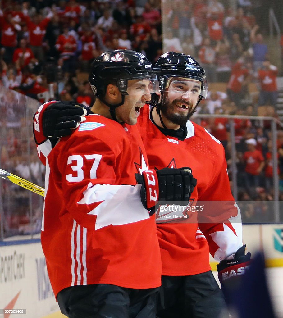 Patrice Bergeron #37 of Team Canada (l) celebrates his goal at 19:59 of the first period against Team Czech Republic and is joined by Drew Doughty #8 during the World Cup of Hockey tournament at the Air Canada Centre on September 17, 2016 in Toronto, Canada.