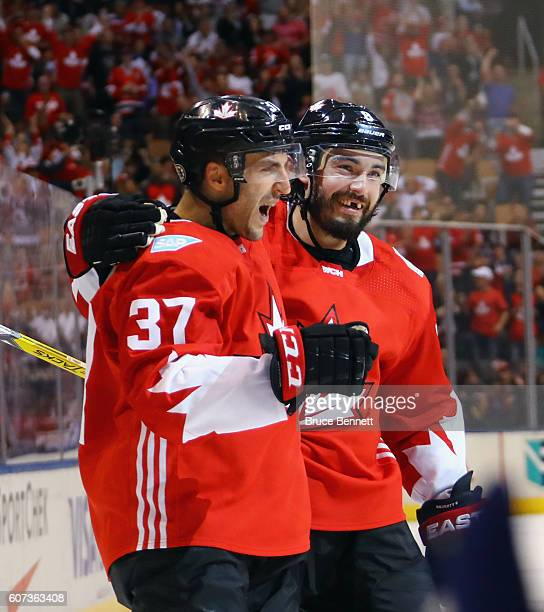 Patrice Bergeron of Team Canada celebrates his goal at 1959 of the first period against Team Czech Republic and is joined by Drew Doughty during the...