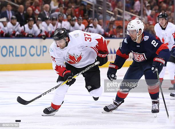 Patrice Bergeron of Team Canada charges up ice with Matt Niskanen of Team USA chasing during the World Cup of Hockey 2016 at Air Canada Centre on...