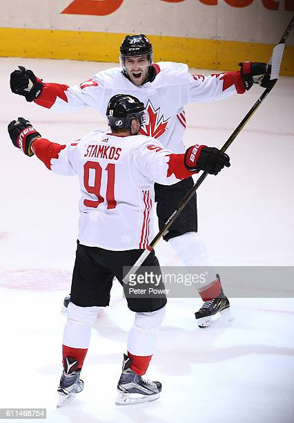 Patrice Bergeron of Team Canada is congratulated by his teammate Steven Stamkos after scoring a third period goal during the third period during Game...