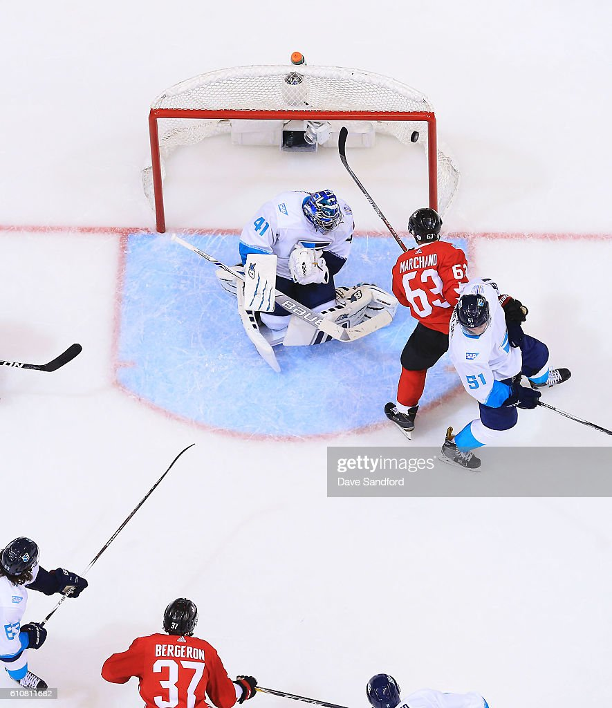 Patrice Bergeron #37 of Team Canada scores on Jaroslav Halak #41 of Team Europe as Brad Marchand #63 of Team Canada battles with Frans Nielsen #51 of Team Europe during Game One of the World Cup of Hockey 2016 final series at Air Canada Centre on September 27, 2016 in Toronto, Canada.
