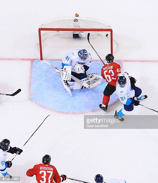 Patrice Bergeron of Team Canada scores on Jaroslav Halak of Team Europe as Brad Marchand of Team Canada battles with Frans Nielsen of Team Europe...
