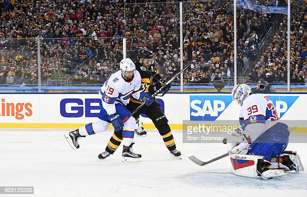 Patrice Bergeron of the Boston Bruins and Andrei Markov of the Montreal Canadiens vie for position in the slot area as goaltender Mike Condon of the...