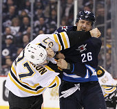 Patrice Bergeron of the Boston Bruins and Blake Wheeler of the Winnipeg Jets fight in second period action in an NHL game at the MTS Centre on...