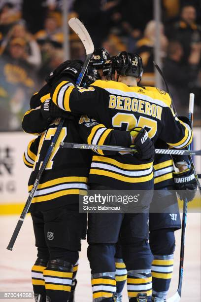 Patrice Bergeron of the Boston Bruins and his line mates celebrate a first period goal against the Toronto Maple Leafs at the TD Garden on November...