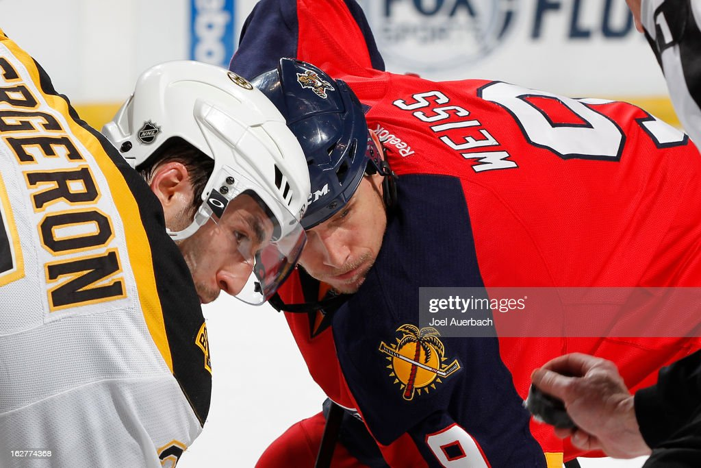 Patrice Bergeron #37 of the Boston Bruins and Stephen Weiss #9 of the Florida Panthers wait for linesman Don Henderson #91 to drop the puck during a face off at the BB&T Center on February 24, 2013 in Sunrise, Florida. The Bruins defeated the Panthers 4-1.