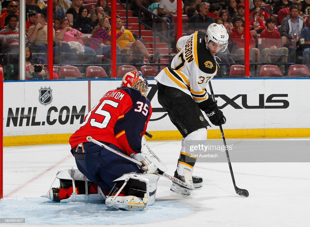 Patrice Bergeron #37 of the Boston Bruins attempts to tip the puck past goaltender Jacob Markstrom #35 of the Florida Panthers at the BB&T Center on February 24, 2013 in Sunrise, Florida.