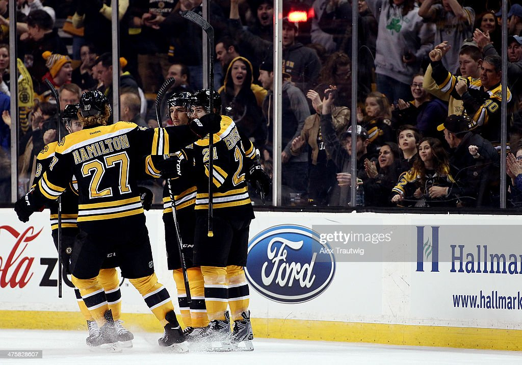 <a gi-track='captionPersonalityLinkClicked' href=/galleries/search?phrase=Patrice+Bergeron&family=editorial&specificpeople=204162 ng-click='$event.stopPropagation()'>Patrice Bergeron</a> #37 of the Boston Bruins celebrates a second period goal with teammates against the Washington Capitals during a game at the TD Garden on March 1, 2014 in Boston, Massachusetts.