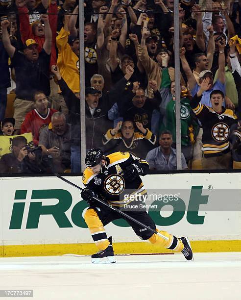 Patrice Bergeron of the Boston Bruins celebrates after scoring a goal in the second period against the Chicago Blackhawks in Game Three of the 2013...