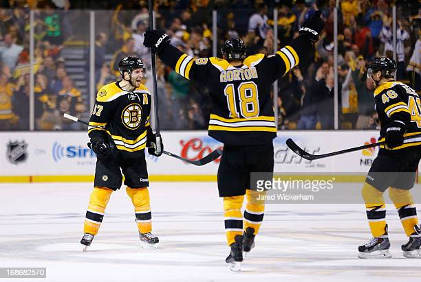 Patrice Bergeron of the Boston Bruins celebrates after scoring the gametying goal in the third period against the Toronto Maple Leafs in Game Seven...