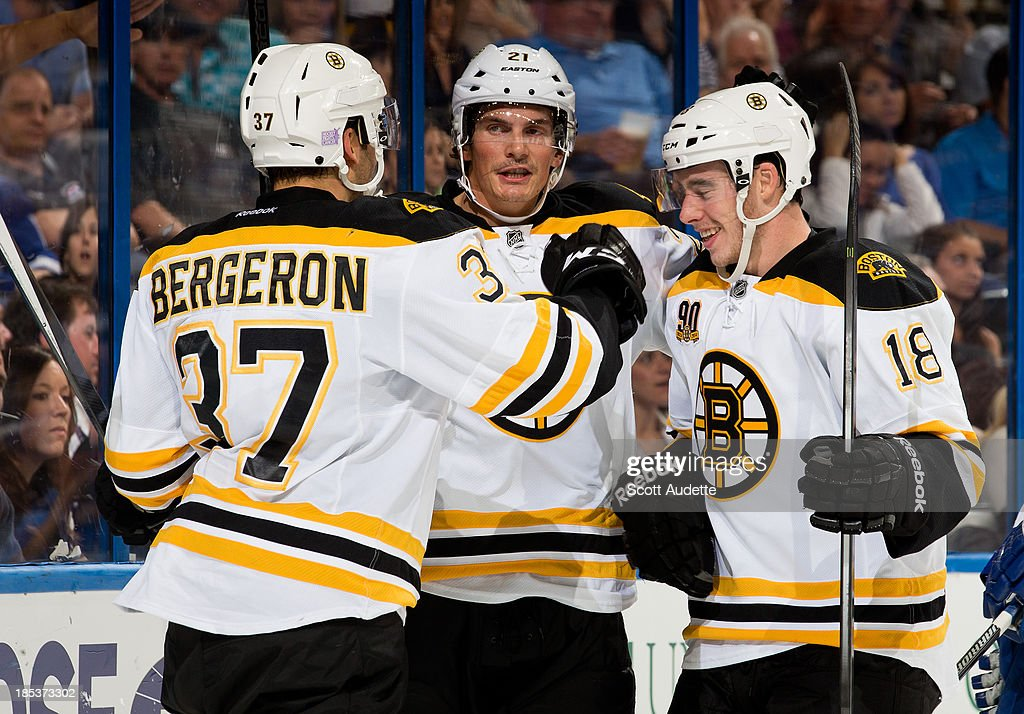 <a gi-track='captionPersonalityLinkClicked' href=/galleries/search?phrase=Patrice+Bergeron&family=editorial&specificpeople=204162 ng-click='$event.stopPropagation()'>Patrice Bergeron</a> #37 of the Boston Bruins celebrates his goal with teammates <a gi-track='captionPersonalityLinkClicked' href=/galleries/search?phrase=Loui+Eriksson&family=editorial&specificpeople=2235241 ng-click='$event.stopPropagation()'>Loui Eriksson</a> #21 and Reilly Smith #18 during the second period of tonight's game against the Tampa Bay Lightning at the Tampa Bay Times Forum on October 19, 2013 in Tampa, Florida.