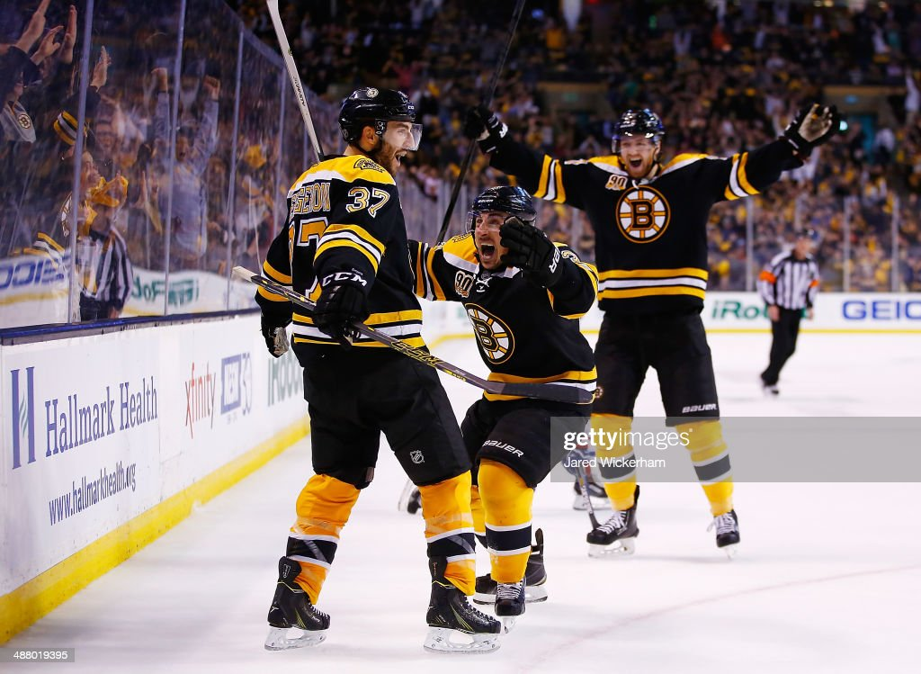 Patrice Bergeron #37 of the Boston Bruins celebrates his tying goal in the third period with teammates Brad Marchand #63 and Dougie Hamilton #27 against the Montreal Canadiens in Game Two of the Second Round of the 2014 NHL Stanley Cup Playoffs at TD Garden on May 3, 2014 in Boston, Massachusetts.