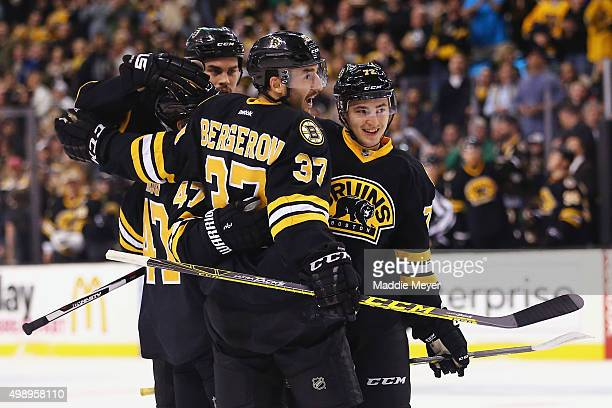 Patrice Bergeron of the Boston Bruins celebrates with Frank Vatrano and Torey Krug after scoring a goal against the New York Rangers during the first...