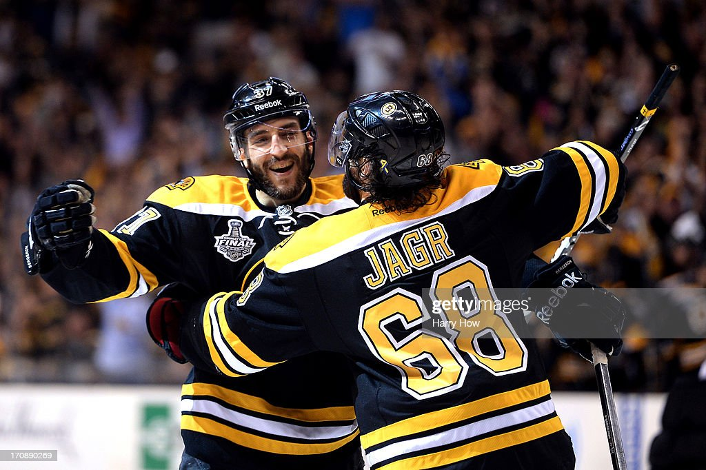 Patrice Bergeron #37 of the Boston Bruins celebrates with Jaromir Jagr #68 after a goal in the third period against the Chicago Blackhawks in Game Four of the 2013 NHL Stanley Cup Final at TD Garden on June 19, 2013 in Boston, Massachusetts.