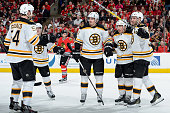 Patrice Bergeron of the Boston Bruins celebrates with Loui Eriksson and Brad Marchand after scoring against the Chicago Blackhawks in the second...