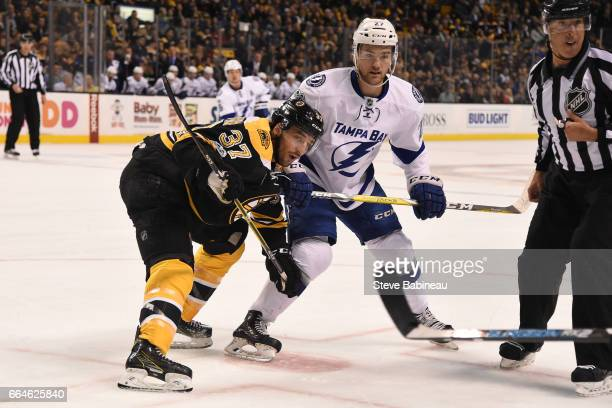 Patrice Bergeron of the Boston Bruins faces off against Jonathan Drouin of the Tampa Bay Lightning at the TD Garden on April 4 2017 in Boston...