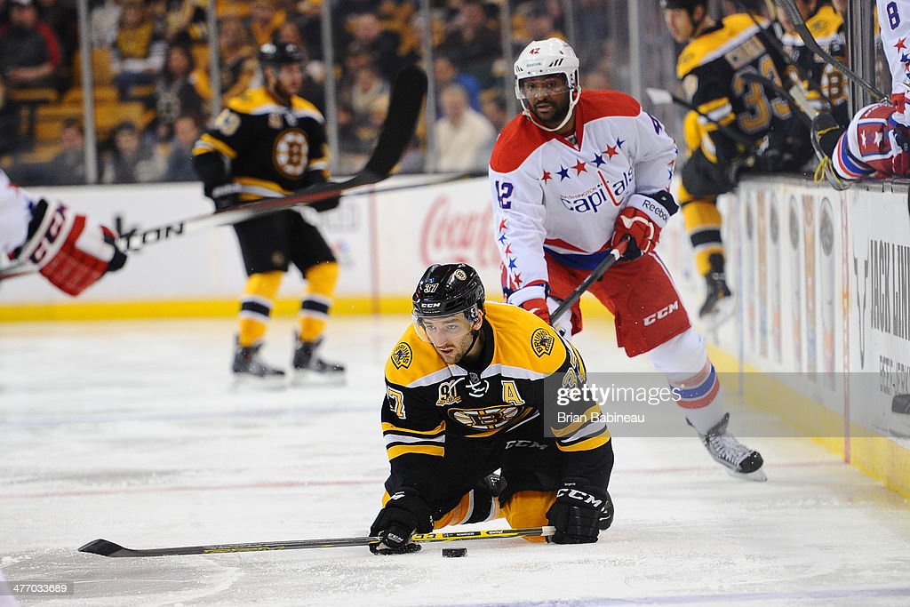 <a gi-track='captionPersonalityLinkClicked' href=/galleries/search?phrase=Patrice+Bergeron&family=editorial&specificpeople=204162 ng-click='$event.stopPropagation()'>Patrice Bergeron</a> #37 of the Boston Bruins fights for posseion of the puck against Joel Ward #42 of the Washington Capitals at the TD Garden on March 6, 2014 in Boston, Massachusetts.