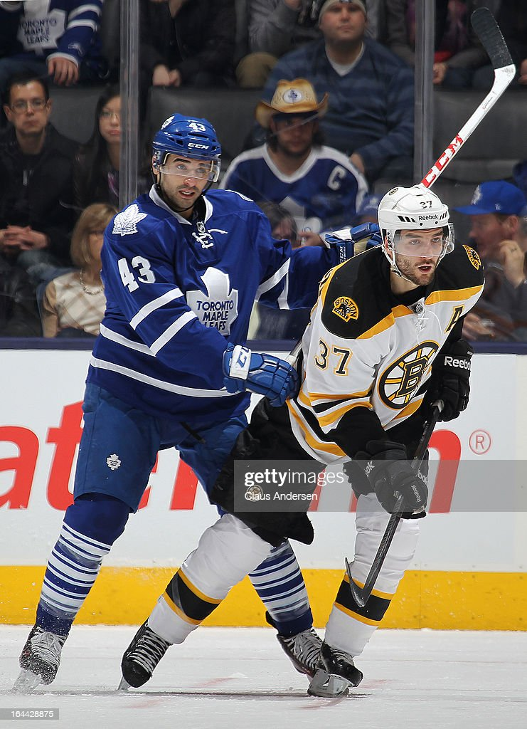 Patrice Bergeron #37 of the Boston Bruins is held in check by Nazem Kadri #43 of the Toronto Maple Leafs in a game on March 23, 2013 at the Air Canada Centre in Toronto, Ontario, Canada.