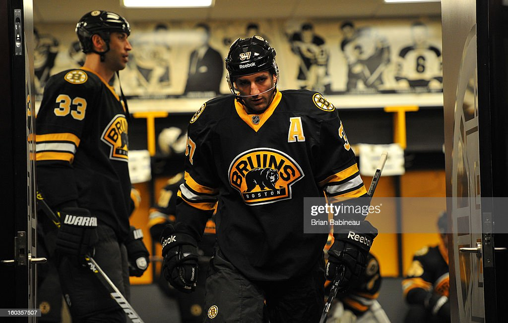 Patrice Bergeron #37 of the Boston Bruins is shown inside the locker room before the game against the New Jersey Devils at the TD Garden on January 29, 2013 in Boston, Massachusetts.