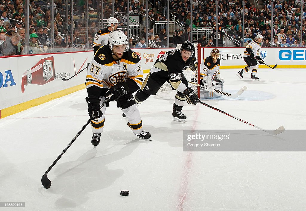 <a gi-track='captionPersonalityLinkClicked' href=/galleries/search?phrase=Patrice+Bergeron&family=editorial&specificpeople=204162 ng-click='$event.stopPropagation()'>Patrice Bergeron</a> #37 of the Boston Bruins moves the puck in front of the defense of <a gi-track='captionPersonalityLinkClicked' href=/galleries/search?phrase=Matt+Cooke&family=editorial&specificpeople=592551 ng-click='$event.stopPropagation()'>Matt Cooke</a> #24 of the Pittsburgh Penguins on March 17, 2013 at Consol Energy Center in Pittsburgh, Pennsylvania. Pittsburgh won the game 2-1.