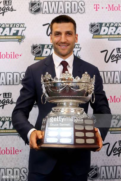 Patrice Bergeron of the Boston Bruins poses after winning the Frank J Selke Trophy during the 2017 NHL Awards and Expansion Draft at TMobile Arena on...
