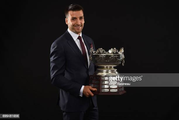 Patrice Bergeron of the Boston Bruins poses for a portrait with the Frank J Selke Trophy at the 2017 NHL Awards at TMobile Arena on June 21 2017 in...