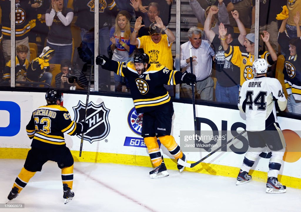 Patrice Bergeron of the Boston Bruins reacts after scoring the game winning goal in double overtime to defeat the Pittsburgh Penguins 21 in Game...