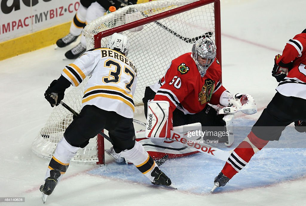 Patrice Bergeron #37 of the Boston Bruins scores a goal against Corey Crawford #50 of the Chicago Blackhawks in the first period at the United Center on February 22, 2015 in Chicago, Illinois.
