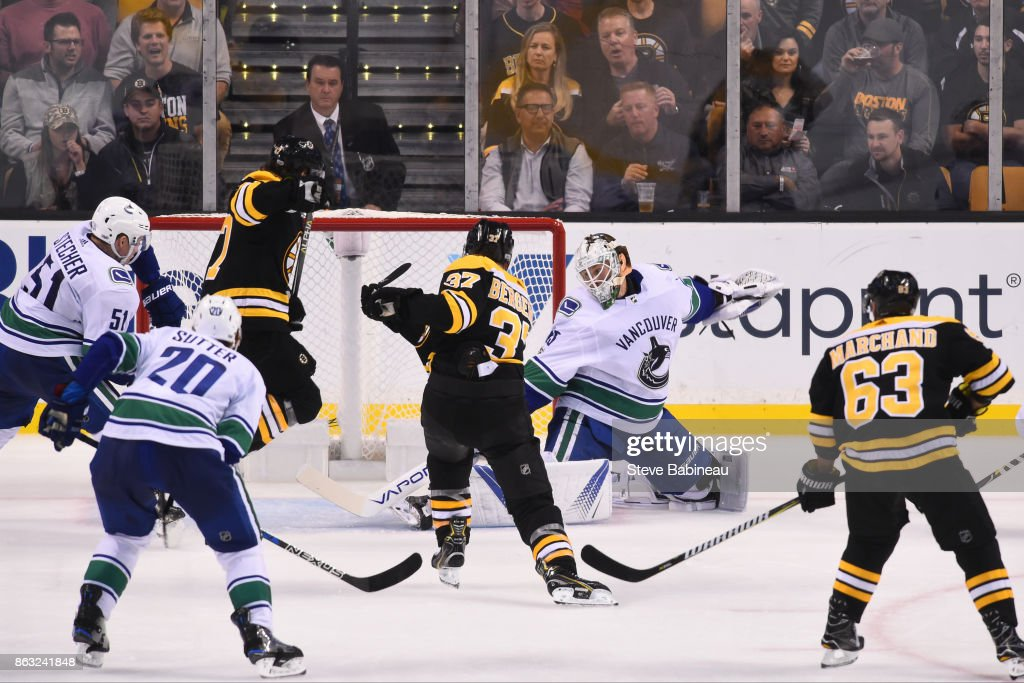 Patrice Bergeron #37 of the Boston Bruins scores a goal in the third period against the Vancouver Canucks at the TD Garden on October 19, 2017 in Boston, Massachusetts.