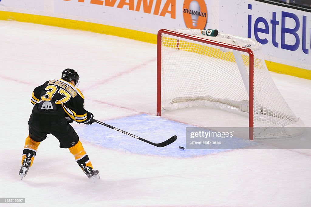 <a gi-track='captionPersonalityLinkClicked' href=/galleries/search?phrase=Patrice+Bergeron&family=editorial&specificpeople=204162 ng-click='$event.stopPropagation()'>Patrice Bergeron</a> #37 of the Boston Bruins scores an empty net goal against the Florida Panthers at the TD Garden on March 14, 2013 in Boston, Massachusetts.