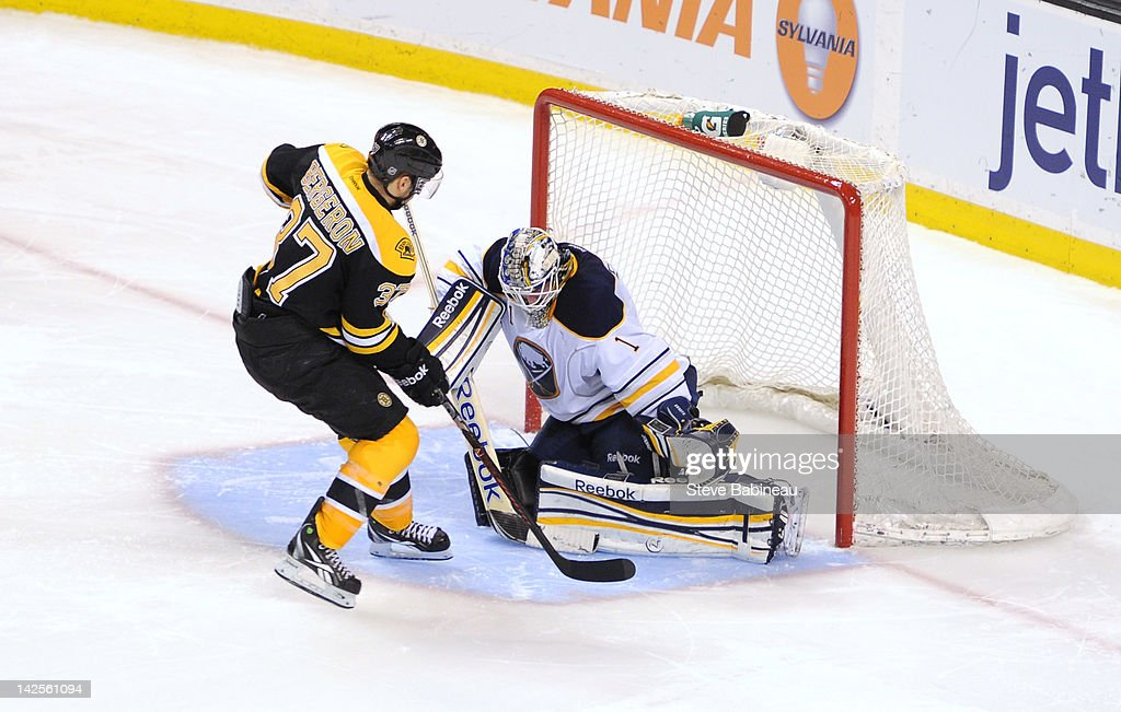 <a gi-track='captionPersonalityLinkClicked' href=/galleries/search?phrase=Patrice+Bergeron&family=editorial&specificpeople=204162 ng-click='$event.stopPropagation()'>Patrice Bergeron</a> #37 of the Boston Bruins scores in a shoot out against <a gi-track='captionPersonalityLinkClicked' href=/galleries/search?phrase=Jhonas+Enroth&family=editorial&specificpeople=570456 ng-click='$event.stopPropagation()'>Jhonas Enroth</a> #1 of the Buffalo Sabres at the TD Garden on April 7, 2012 in Boston, Massachusetts.