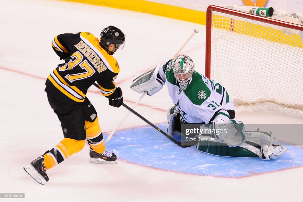 <a gi-track='captionPersonalityLinkClicked' href=/galleries/search?phrase=Patrice+Bergeron&family=editorial&specificpeople=204162 ng-click='$event.stopPropagation()'>Patrice Bergeron</a> #37 of the Boston Bruins scores in a shoot out against Karl Lehtonen #32 of the Dallas Stars at the TD Garden on November 5, 2013 in Boston, Massachusetts.