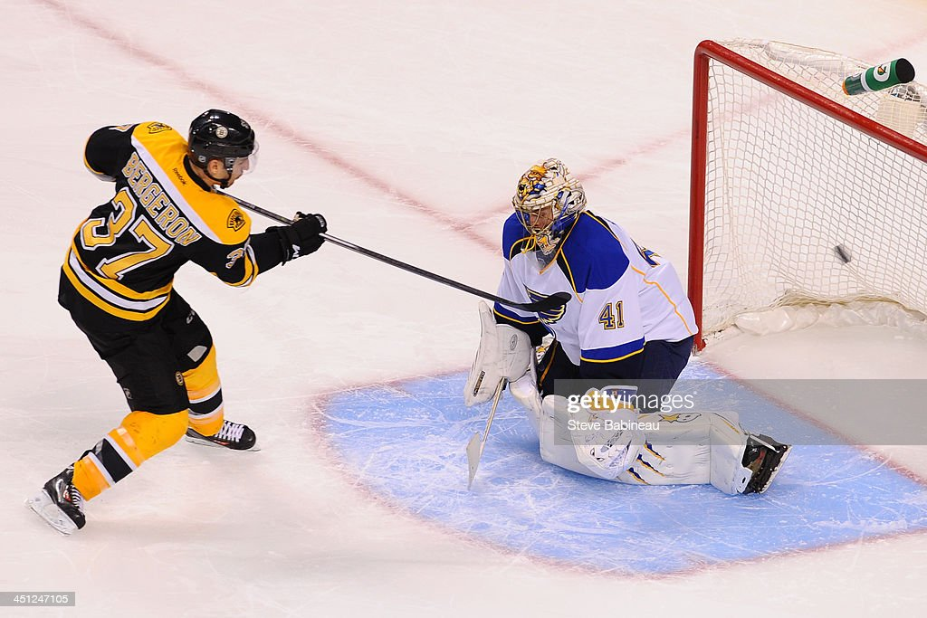 <a gi-track='captionPersonalityLinkClicked' href=/galleries/search?phrase=Patrice+Bergeron&family=editorial&specificpeople=204162 ng-click='$event.stopPropagation()'>Patrice Bergeron</a> #37 of the Boston Bruins scores in a shoot out against <a gi-track='captionPersonalityLinkClicked' href=/galleries/search?phrase=Jaroslav+Halak&family=editorial&specificpeople=2285591 ng-click='$event.stopPropagation()'>Jaroslav Halak</a> #41 of the St. Louis Blues at the TD Garden on November 21, 2013 in Boston, Massachusetts.