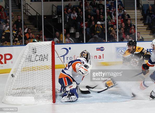 Patrice Bergeron of the Boston Bruins scores past Rick DiPietro of the New York Islanders at 708 of the first period at the Nassau Veterans Memorial...