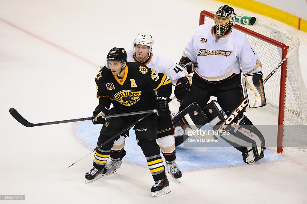<a gi-track='captionPersonalityLinkClicked' href=/galleries/search?phrase=Patrice+Bergeron&family=editorial&specificpeople=204162 ng-click='$event.stopPropagation()'>Patrice Bergeron</a> #37 of the Boston Bruins screens <a gi-track='captionPersonalityLinkClicked' href=/galleries/search?phrase=Cam+Fowler&family=editorial&specificpeople=5484080 ng-click='$event.stopPropagation()'>Cam Fowler</a> #4 and <a gi-track='captionPersonalityLinkClicked' href=/galleries/search?phrase=Jonas+Hiller&family=editorial&specificpeople=743364 ng-click='$event.stopPropagation()'>Jonas Hiller</a> #1 of the Anaheim Ducks at the TD Garden on October 31, 2013 in Boston, Massachusetts.