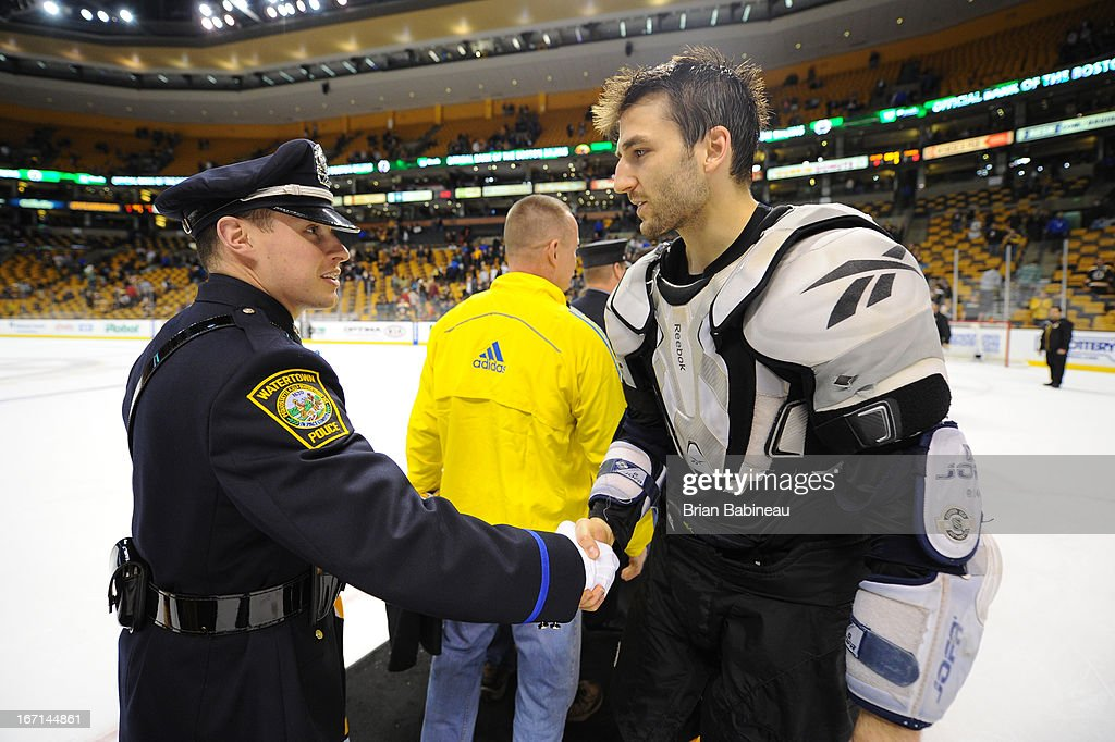 <a gi-track='captionPersonalityLinkClicked' href=/galleries/search?phrase=Patrice+Bergeron&family=editorial&specificpeople=204162 ng-click='$event.stopPropagation()'>Patrice Bergeron</a> #37 of the Boston Bruins shakes hands with one of the first responders from the Boston Marathon tragedy after the game against the Florida Panthers at the TD Garden on April 21, 2013 in Boston, Massachusetts.